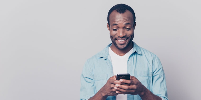 African man with smartphone